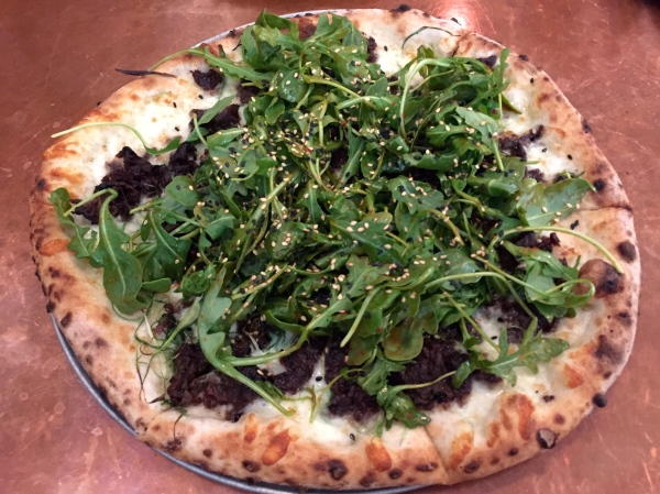 Korean BBQ Pizza - Grass Run Farm Beef Short Ribs, Mozzarella, Scallions, Arugula, Sesame & Soy-Chili Vinaigrette ($17)
